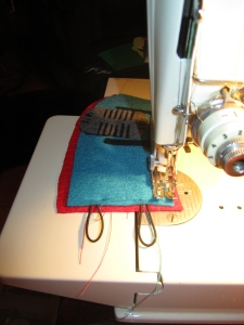 Stitching the coffee cozy panels.