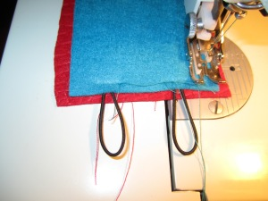 Stitching the elastic loops onto the end of the cozy