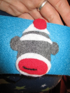 Stitching my sock monkey accents.