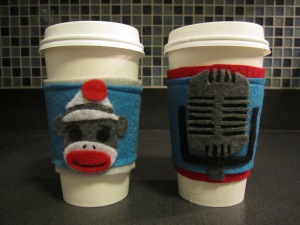 Sock monkey and old microphone coffee cozy