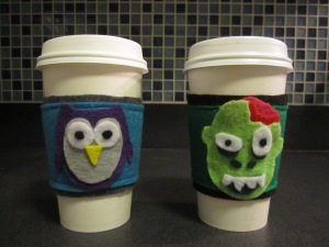 Owl and zombie coffee cozy