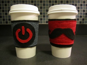 Power On and mustache coffee cozy